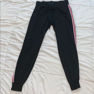 Black joggers with red and white stripe